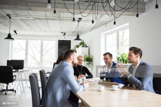 executives having a meeting in office - staff meeting stock pictures, royalty-free photos & images
