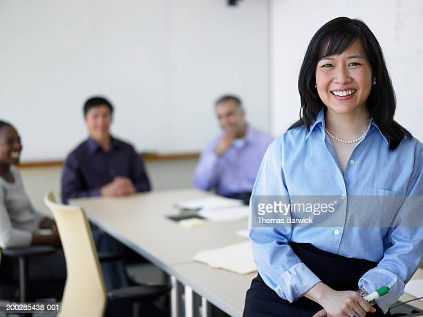 executives in board room (focus on woman in foreground) - blouse stock pictures, royalty-free photos & images