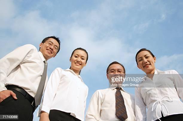 executives looking down at camera, smiling - down blouse stock-fotos und bilder