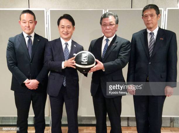 Executives of Toshiba Corp and DeNA Co pose during a press conference in Tokyo on Dec 6 as Toshiba announces the sale of its professional basketball...