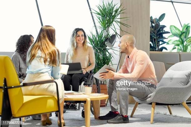 executives planning strategy in meeting at office - differing abilities female business fotografías e imágenes de stock
