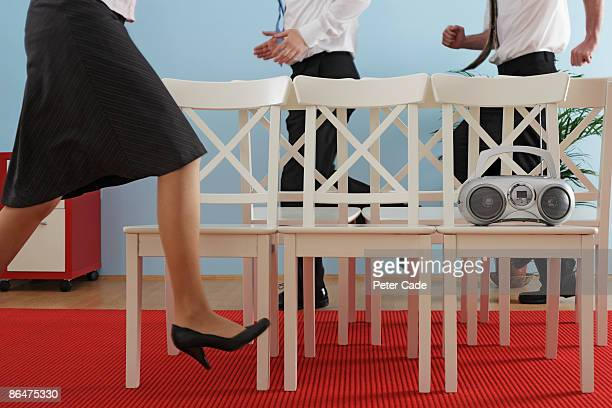 executives playing musical chairs - low section stock pictures, royalty-free photos & images