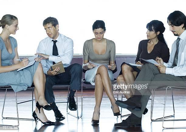 Executives sitting, having meeting