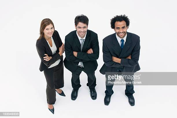 Executives standing together with arms folded, portrait