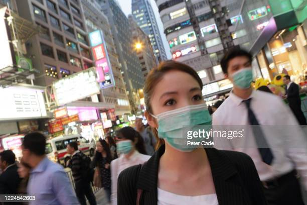 executives walking through city wearing protective face masks - 重症急性呼吸器症候群 ストックフォトと画像