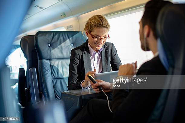 executives working on train - passenger train stock photos and pictures