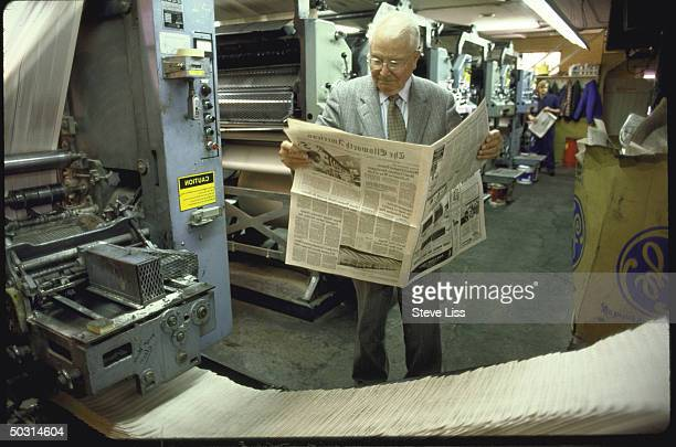Exeditor of Washington Post now editor of small town paper J Russell Wiggins reading copy of The Ellsworth American hot off the presses