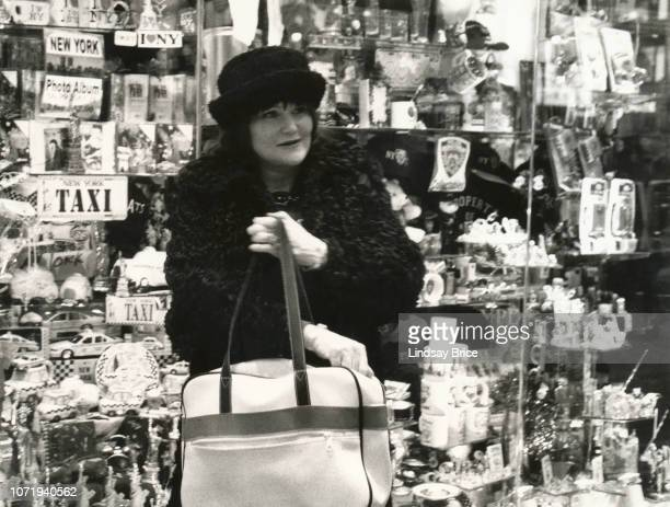 Exene Cervenka stands before a souvenir shop window in Times Square on March 25 2000 in New York City