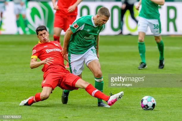 Exequiel Palacios of Bayer 04 Leverkusen and Niclas Fuellkrug of SV Werder Bremen battle for the ball during the Bundesliga match between SV Werder...