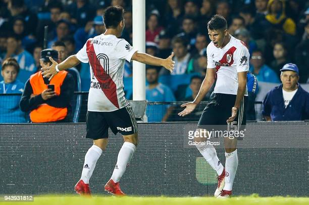 Exequiel Palacios of River Plate celebrates with teammate Gonzalo Martinez after scoring the second goal of his team during a match between Racing...