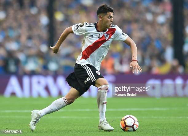 Exequiel Palacios of River Plate drives the ball during the first leg match between Boca Juniors and River Plate as part of the Finals of Copa...