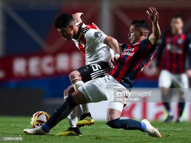 Exequiel Palacios of River Plate fights for the ball with Victor Salazar of San Lorenzo during a match between San Lorenzo and River Plate as part of...