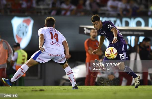Exequiel Palacios of River Plate kicks the ball against Bruno Pittón of Union during a match between River Plate and Union as part of Round 12 of...