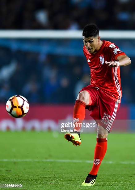 Exequiel Palacios of River Plate kicks the ball during a round of sixteen first leg match between River Plate and Racing Club as part of Copa...