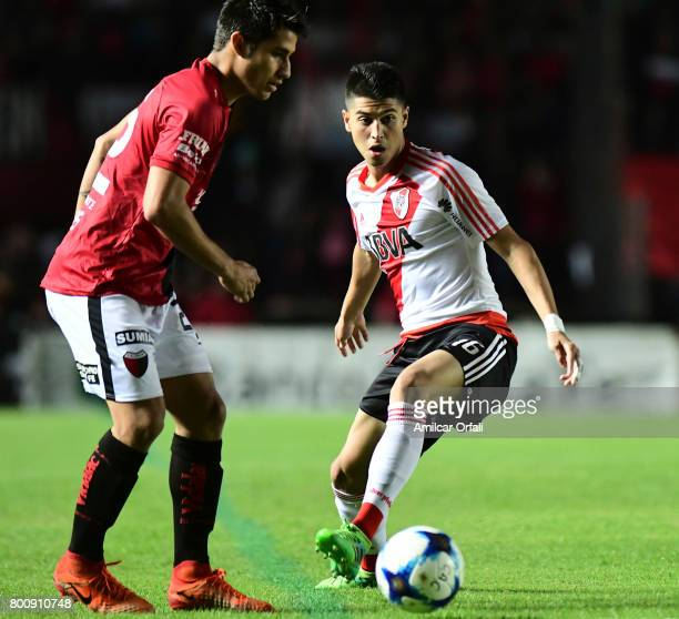 Exequiel Palacios of River Plate vies for the ball with Ivan Torres of Colon during a match between Colon and River Plate as part of Torneo Primera...