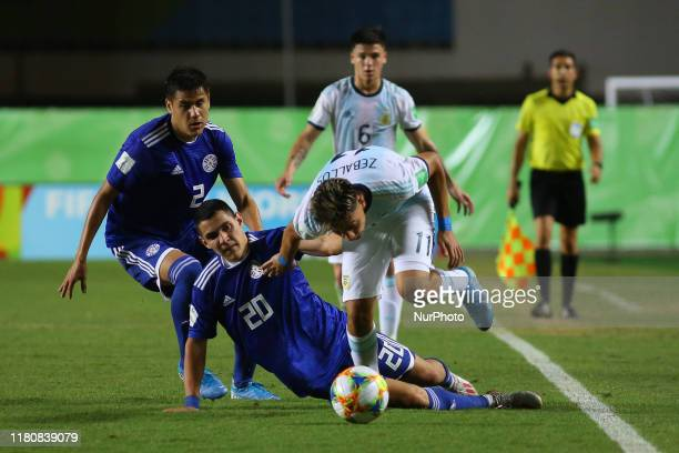 Exequiel Zeballos of Argentina and Diego Torres of Paraguay fight for the ball during the FIFA U17 World Cup Brazil 2019 round of 16 match between...