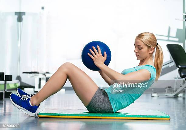 exercise abs with medicine ball in gym - circuit training stock photos and pictures