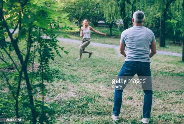 exercise at backyard during covid-19 pandemic - racket sport stock pictures, royalty-free photos & images