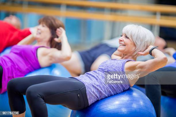 exercise balls - fitness ball stock pictures, royalty-free photos & images