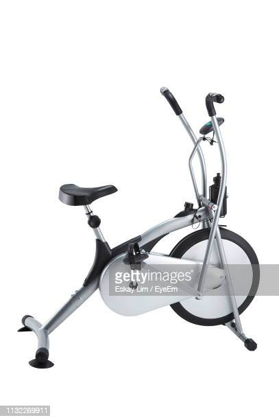 exercise bike against white background - peloton stock pictures, royalty-free photos & images
