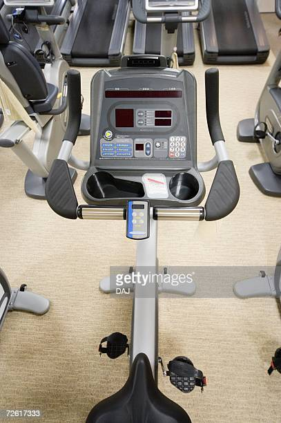 Exercise bike in gym, high angle view, close up
