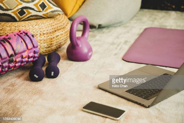 exercise equipments, laptop laying on the floor - home workout stock pictures, royalty-free photos & images