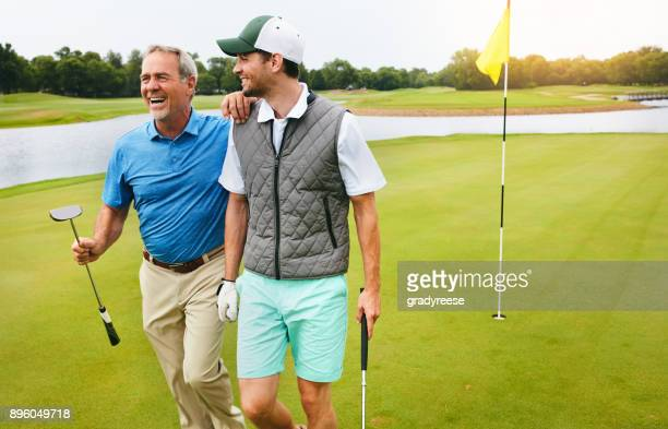 exercise, fresh air, friends and laughter - golfe imagens e fotografias de stock