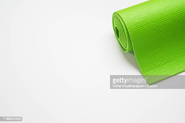 exercise mat against white background - エクササイズマット ストックフォトと画像
