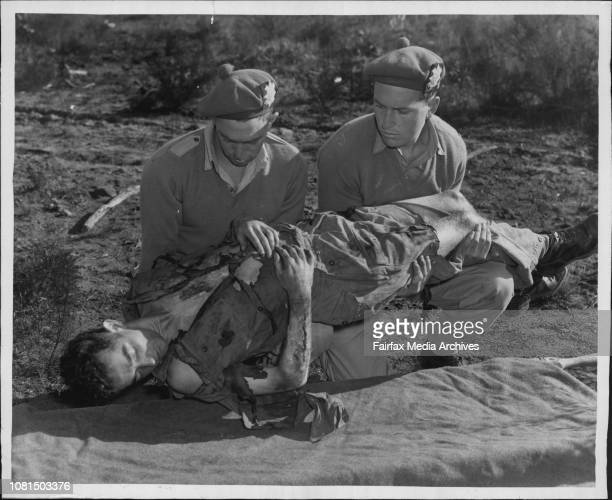 Exercise Monitor Stretcher Bearers Pte Ron Mountford and Geoff Chard lift Casualty Pte Mike Mealy on to a stretcher near the scene ***** of the Atom...