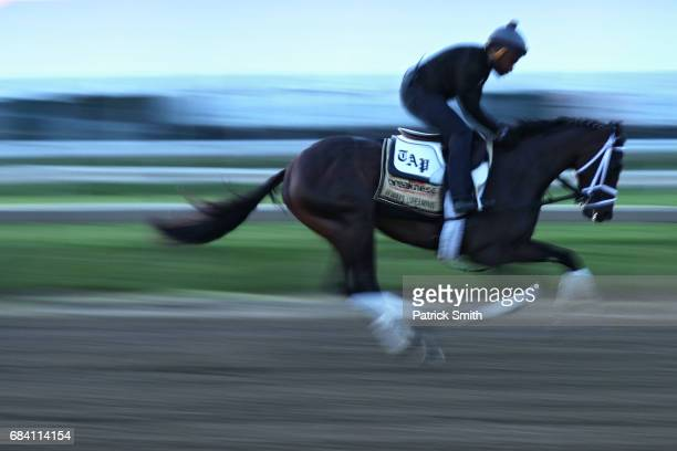 Exercise rider Nick Bush rides Kentucky Derby winner Always Dreaming on the track during a training session for the upcoming Preakness Stakes at...