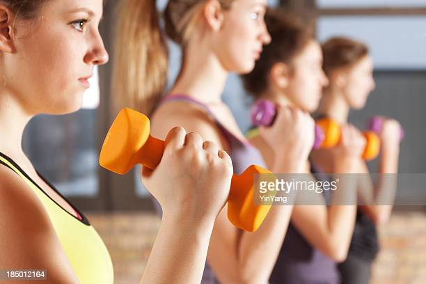 Exercise Sport and Working Out Group in Health Club Gymnasium