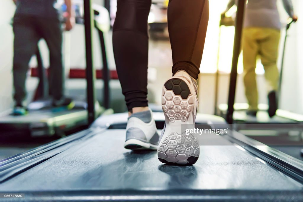 Exercise treadmill cardio running workout at fitness gym of woman taking weight loss with machine aerobic for slim and firm healthy in the morning. concept of running and sports. running athletes : Stock Photo