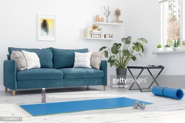 自宅でのエクササイズ - エクササイズマット ストックフォトと画像