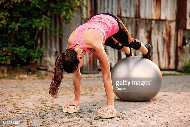 Exercisies for abs with pilates ball outdoors