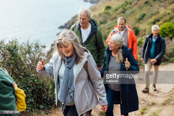exercising as a group - mature adult stock pictures, royalty-free photos & images