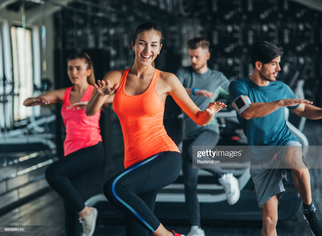 Exercising at the gym : Stock Photo