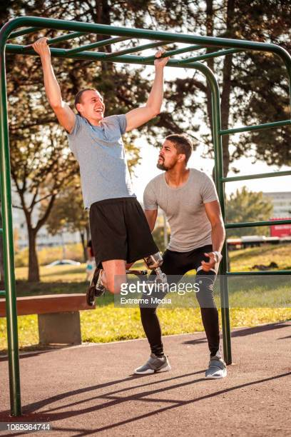 Exercising chin-ups in the outdoor gym