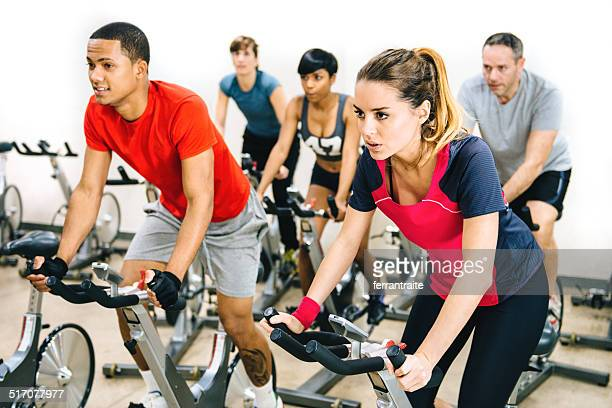 exercising class - spinning stock pictures, royalty-free photos & images