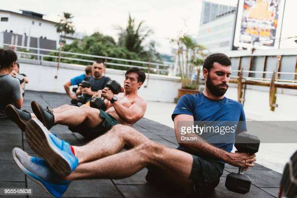 exercising in the summer in malaysia - asian six pack stock photos and pictures