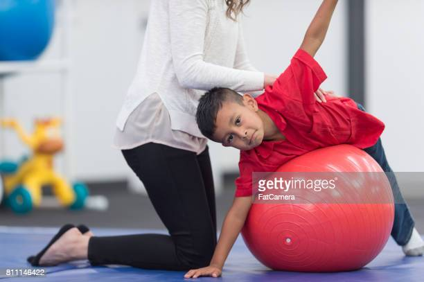 Exercising kids in physical therapy clinic