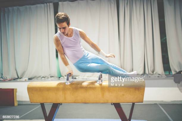 Exercising on pommel horse.