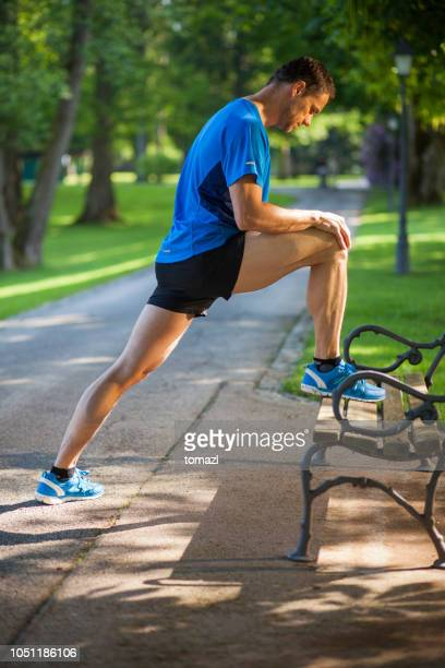 exercising on the park bench - human muscle stock pictures, royalty-free photos & images