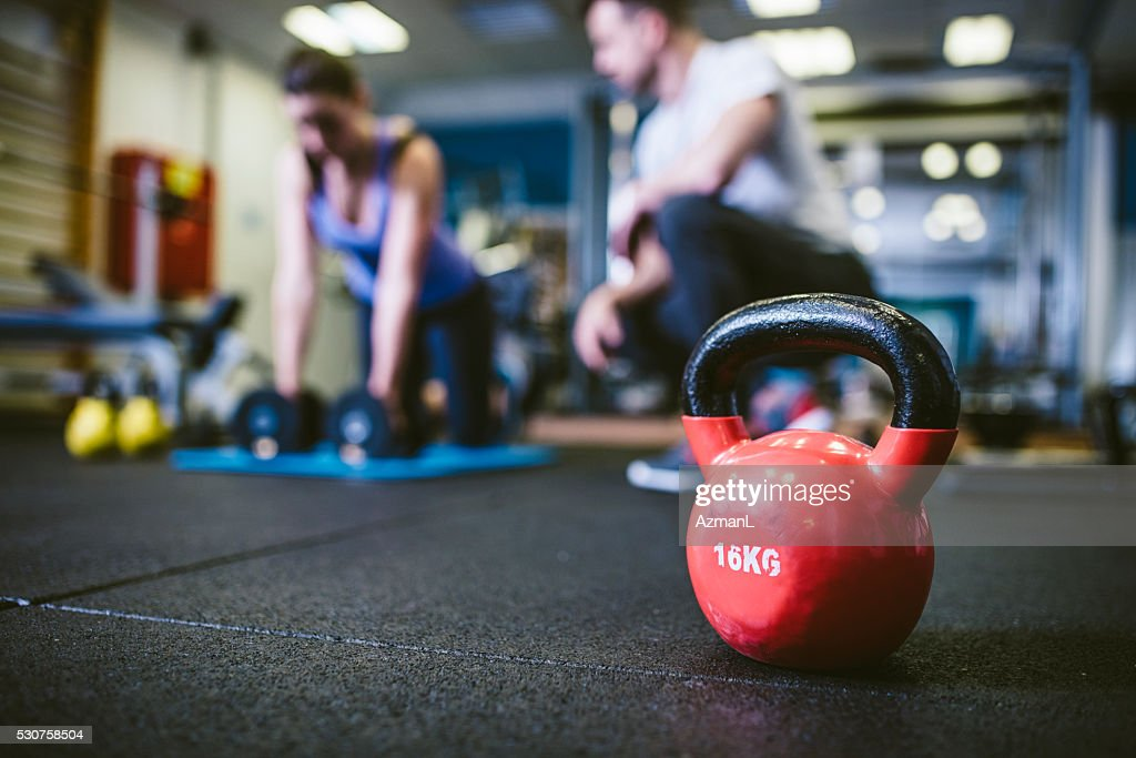 Exercising with personal trainer : Stock Photo