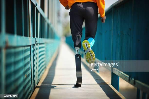 Exercising with prosthetic leg.