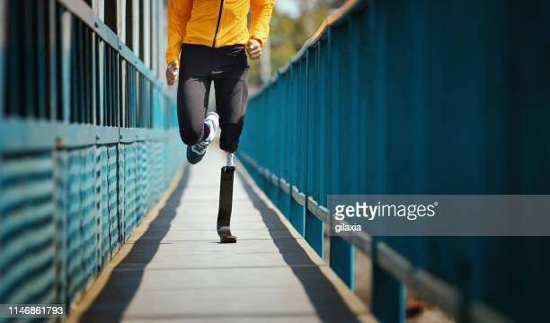 exercising with prosthetic leg. - limb body part stock pictures, royalty-free photos & images