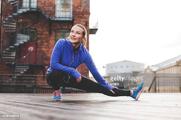 exercising woman outdoors - sportswear stock pictures, royalty-free photos & images