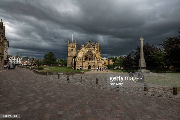 Exeter Cathedral yard under stormy sky
