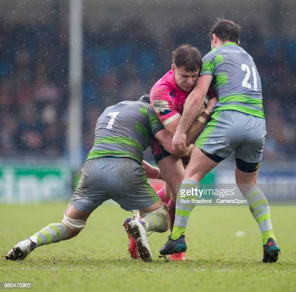 Exeter Cheifs' Ollie Devoto is tackled by 'Newcastle Falcons' Micky Young and Will Welch during the Anglo Welsh Cup Semi Final match between Exeter...