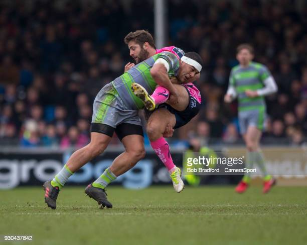 Exeter Cheifs' Santiago Cordero is tackled by Newcastle Falcons' Joel Matavesi during the Anglo Welsh Cup Semi Final match between Exeter Chiefs and...