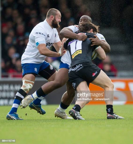 Exeter Chiefs' Alec Hepburn is tackled by Bath Rugby's Beno Obano and Tom Dunn during the Aviva Premiership match between Exeter Chiefs and Bath...